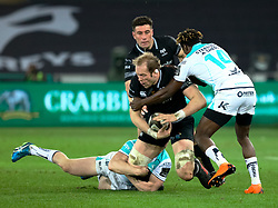 Ospreys' Alun Wyn Jones is tackled by Connacht's Eoin Griffin<br /> <br /> Photographer Simon King/Replay Images<br /> <br /> Guinness PRO14 Round 19 - Ospreys v Connacht - Friday 6th April 2018 - Liberty Stadium - Swansea<br /> <br /> World Copyright © Replay Images . All rights reserved. info@replayimages.co.uk - http://replayimages.co.uk