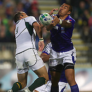 Morne Steyn, South Africa, (left) and Tusi Pisi, Samoa, challenge for the ball during the South Africa V Samoa, Pool D match during the IRB Rugby World Cup tournament. North Harbour Stadium, Auckland, New Zealand, 30th September 2011. Photo Tim Clayton...