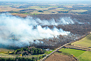 Aerial view of an autumn burn of a forest in rural Dane County, Wisconsin.