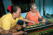 Anne trying traditional weaving. We decided to buy some prepared by the local experts instead . . .