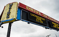 The Weirs Beach Theater marquee flashes the names of headliners that will be coming to Laconia Fest during Motorcycle Week starting this weekend.  (Karen Bobotas/for the Laconia Daily Sun)