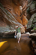 Obadiah Reid explores a slot canyon of Lost Creek along the Goose Creek Trail, Lost Creek Wilderness, Colorado.