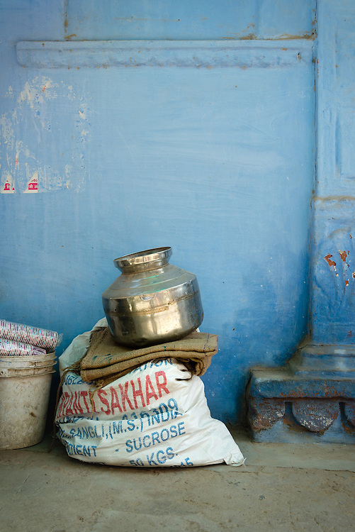 Brass water jug with blue wall