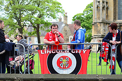 Fans before the victory parade through Lincoln City centre.