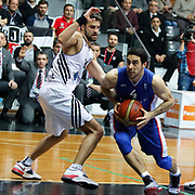 Besiktas integral Forex's Engin Atsur (L) and Anadolu Efes's Dogus Balbay (R) during their Turkish basketball league match Besiktas integral Forex between Anadolu Efes at BJK Akatlar Arena in Istanbul, Turkey, Monday, January 05, 2015. Photo by TURKPIX