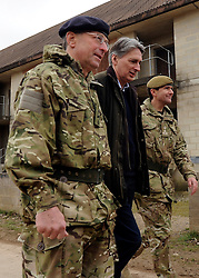 © Licensed to London News Pictures. 09/03/2012. Copedown Hill, UK. Left to right David Richards, Chief of Defence Staff and Secretary of Defence Philip Hammond visit troops during the day. The 12thMechanized Brigade (12 Mech Bde) at Copehill Down, Salisbury Plain Training Area, Wiltshire,on FRIDAY 09 MARCH 2012, as it prepares to deploy to Helmand Province, Afghanistan, on Operation Herrick 16, in the Spring of this year. The Brigade were performing a dynamic demonstration of combined Afghan/ISAF operations supported by surveillance assets and casualty evacuation capability. Tornado GR4 fast jest ground support was also displayed.. Photo credit : Stephen SImpson/LNP