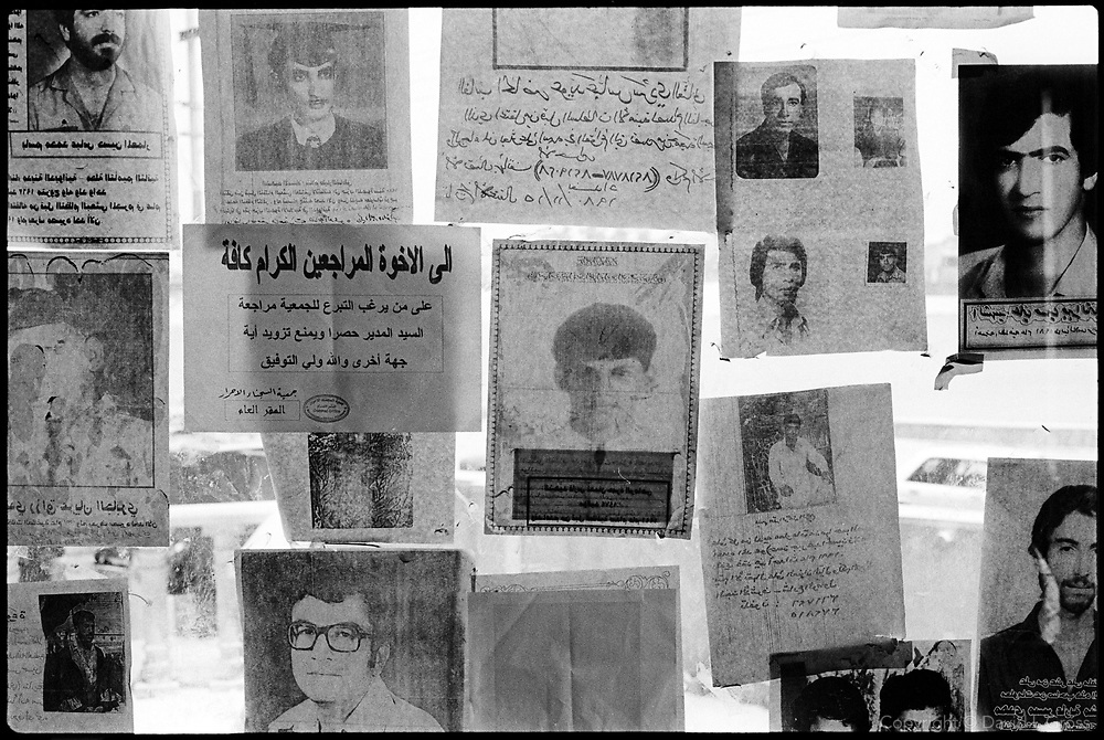 Posters ask for help finding lost relatives inside the Committee of Freed Prisoners in Baghdad, Iraq.