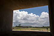 Mcc0084404 . Daily Telegraph<br /> <br /> Aeolus Satellite Launch<br /> <br /> The Vega launch pad at the European Space Centre in French Guiana seen through the exhaust port of the Ariane 5 site , where the Aeolus Satellite will be propelled into orbit around the earth .<br />  . <br /> The Aeolus Satellite, designed and built by Airbus contains pioneering technology that will monitor winds around the globe that will change weather forecasting forever .<br /> <br /> Kourou, French Guiana 21 August 2018