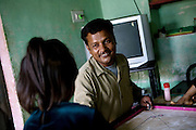 Shafiq Syed, 34, is smiling at his daughter, Simran, 7, while playing with his children in their home inside a poor neighbourhood of Bangalore, Karnataka, India. Shaifq has been the main character of the Cannes' Camera D'Or 1988 winner Salaam Bombay, but after the movie he failed to become a star, fell back into poverty and lived on the streets for years before he became a rickshaw (tuk-tuk) driver in his home city of Bangalore, Karnataka State, India.