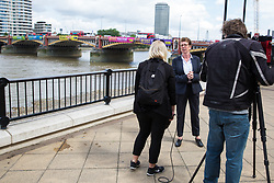 London, UK. 3 June, 2019. Kate Allen, Amnesty UK Director, is interviewed as five brightly-coloured banners bearing the slogans 'Resist Trump', 'Resist sexism', 'Resist racism', 'Resist hate' and 'Resist cruelty' are dropped on Vauxhall Bridge in view of the US embassy by activists from Amnesty International at the beginning of President Donald Trump's three-day state visit to the UK. Amnesty International has written to Prime Minister Theresa May has written to Theresa May to urge her to raise human rights issues directly with the US President.