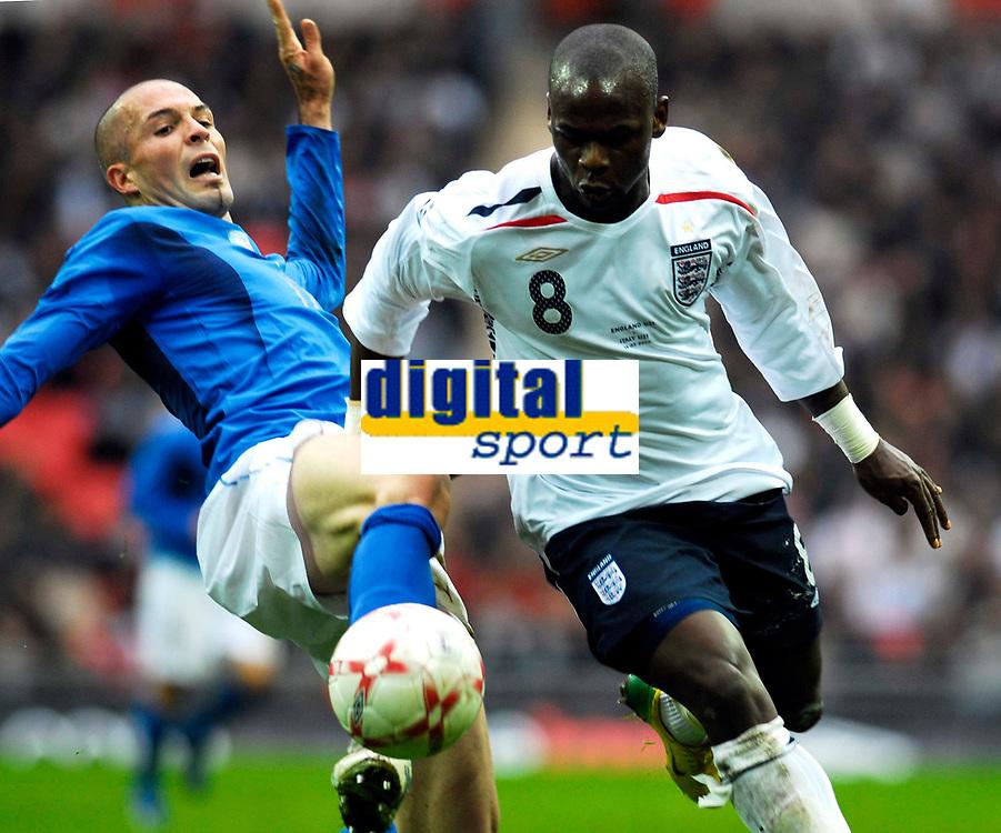 Photo: Alan Crowhurst.<br />England U21 v Italy U21. International Friendly. 24/03/2007. England's Leroy Lita (R) challenges with Andrea Raggi.