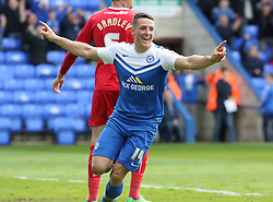 Peterborough United's Connor Washington celebrates scoring the equaliser - Photo mandatory by-line: Joe Dent/JMP - Mobile: 07966 386802 - 25/04/2015 - SPORT - Football - Peterborough - ABAX Stadium - Peterborough United v Crawley Town - Sky Bet League One
