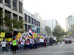 April 15, 2018 - Los Angeles, California, USA - Marchers take to street in downtown Los Angeles protesting United States military actions in Syria, Los Angeles, California, USA, April 14, 218...Credit Image cr Scott Mitchell/ZUMA Press (Credit Image: © Scott Mitchell via ZUMA Wire)