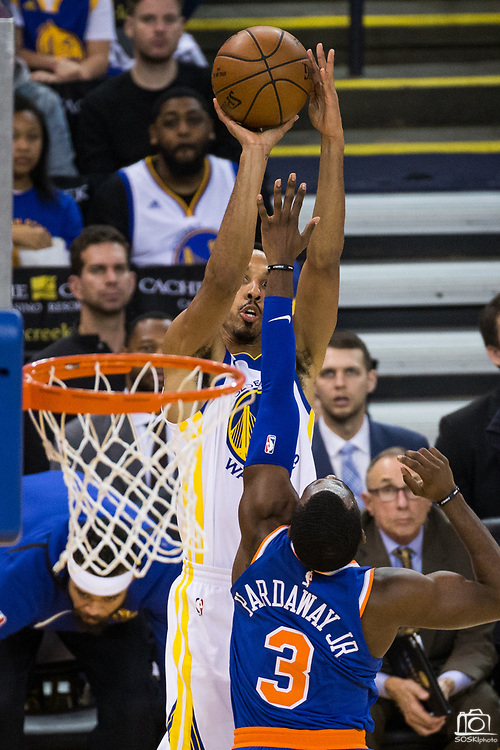 Golden State Warriors guard Shaun Livingston (34) shoots a three pointer over New York Knicks forward Tim Hardaway Jr. (3) at Oracle Arena in Oakland, Calif., on May 2, 2017. (Stan Olszewski/Special to S.F. Examiner)