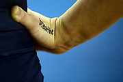 """A detailed view of the word """"breathe"""" is seen on the hand of Abby Brenner of the Michigan Wolverines before their meet against Iowa at Crisler Center on February 10, 2019 in Ann Arbor, Michigan."""