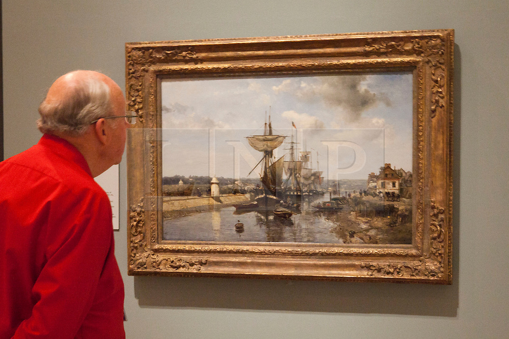 © under license to London News Pictures. 25/06/12. London, UK. A visitor admires the famous paining, The Loing and the Mills of Moret-Snow Effect by Alfred Sisley. The exhibition takes place at the Royal Academy of Arts. From Paris: A Taste of Impressionism - paintings from the Clark exhibition. The exhibition showcases seventy major works, many of which have never been on public display in the U.K before...ALEX CHRISTOFIDES/LNP