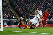 Duncan Watmore of Sunderland just manages to clear the danger to keep Liverpool out. Premier League match, Liverpool v Sunderland at the Anfield stadium in Liverpool, Merseyside on Saturday 26th November 2016.<br /> pic by Chris Stading, Andrew Orchard sports photography.