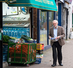 © Licensed to London News Pictures. 11/11/2015. London, UK. Labour Party leader JEREMY CORBYN  leaving a newsagents in Islington, north London carrying a newspaper on the day that he is due to be sworn in to Privy Council by Queen Elizabeth II. It is not known if Corbyn, who is a republican, will kneel in front of the Queen,  normally a requirement as part of a swearing-in ceremony for the group that advises monarchs.  Photo credit: Ben Cawthra/LNP