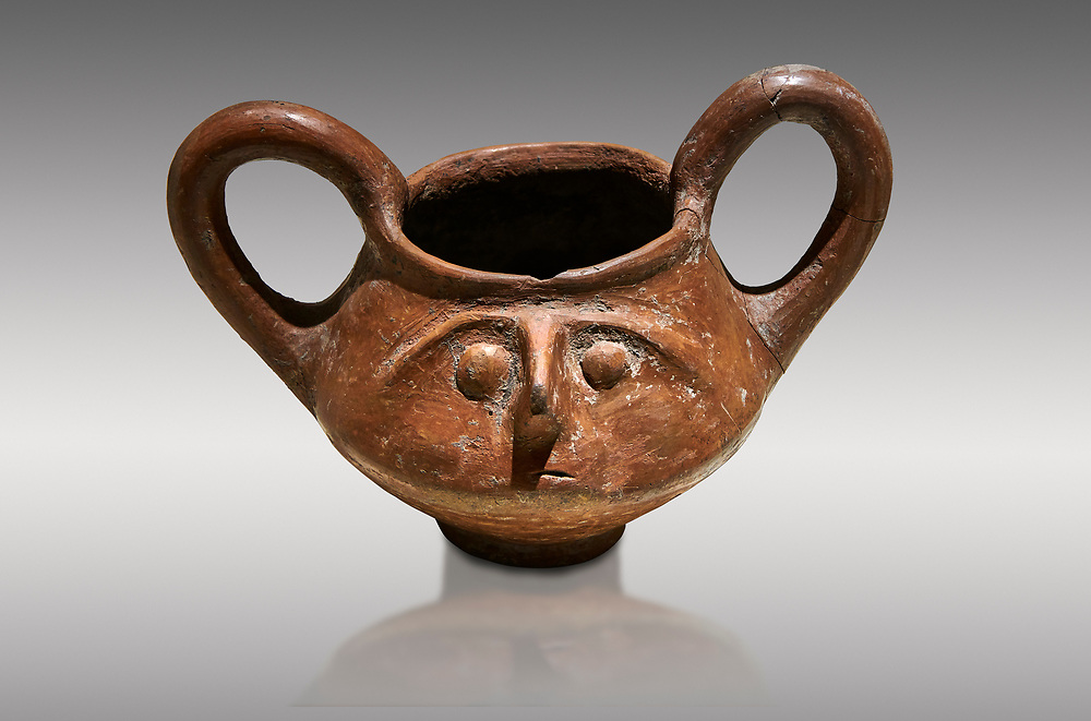 Hittite terra cotta double handled jug with a relief human face- 17th - 16th century BC - Hattusa ( Bogazkoy ) - Museum of Anatolian Civilisations, Ankara, Turkey. Against gray background .<br /> <br /> If you prefer to buy from our ALAMY STOCK LIBRARY page at https://www.alamy.com/portfolio/paul-williams-funkystock/hittite-art-antiquities.html  - Type Hattusa into the LOWER SEARCH WITHIN GALLERY box. Refine search by adding background colour, place, museum etc<br /> <br /> Visit our HITTITE PHOTO COLLECTIONS for more photos to download or buy as wall art prints https://funkystock.photoshelter.com/gallery-collection/The-Hittites-Art-Artefacts-Antiquities-Historic-Sites-Pictures-Images-of/C0000NUBSMhSc3Oo