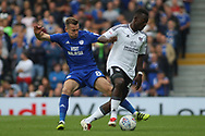 Joe Rails of Cardiff City (L) tackles Ibrahima Cisse of Fulham (R). EFL Skybet football league championship match, Fulham v Cardiff city at Craven Cottage in London on Saturday 9th September 2017.<br /> pic by Steffan Bowen, Andrew Orchard sports photography.