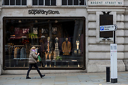 © Licensed to London News Pictures. 19/01/2021. LONDON, UK.  The exterior of the Superdry flagship retail store on Regent Street in the West End.  The retail group has issued a warning over its ability to continue as a going concern due to the negative effects of lockdown during the ongoing coronavirus panademic on sales and profits.  Photo credit: Stephen Chung/LNP