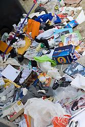 Piles of rubbish lying in street,