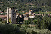 The pre-Romanesque tower of the Abbey of Sante-Marie DOrbieu and the church of Saint-Michel, on 21st May 2017, in Lagrasse, Languedoc-Rousillon, south of France. Lagrasse is listed as one of Frances most beautiful villages and lies on the famous Route 20 wine route in the Basses-Corbieres region dating to the 13th century.