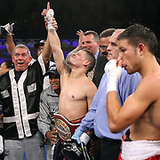 "Orlando Cruz, (green trunks) celebrates his victory after defeating Jorge Pazos at the Kissimmee Civic Center in Kissimmee, Florida, on Friday, October 19, 2012. The Puerto Rican Cruz recently described himself as ""a proud gay man"" and the first active boxer having pronounced so, in boxing history. Cruz won the fight via 12 round decision. (AP Photo/Alex Menendez)"
