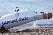 A giant message in a bottle has washed up on the beach from countries ravaged by climate change, on a beach on the 12th of June 2021 near Falmouth, Cornwall, United Kingdom. Oxfam is calling on the G7 countries to commit to cutting emissions further and faster and provide more finance to help the most vulnerable countries respond to the impacts of climate change.