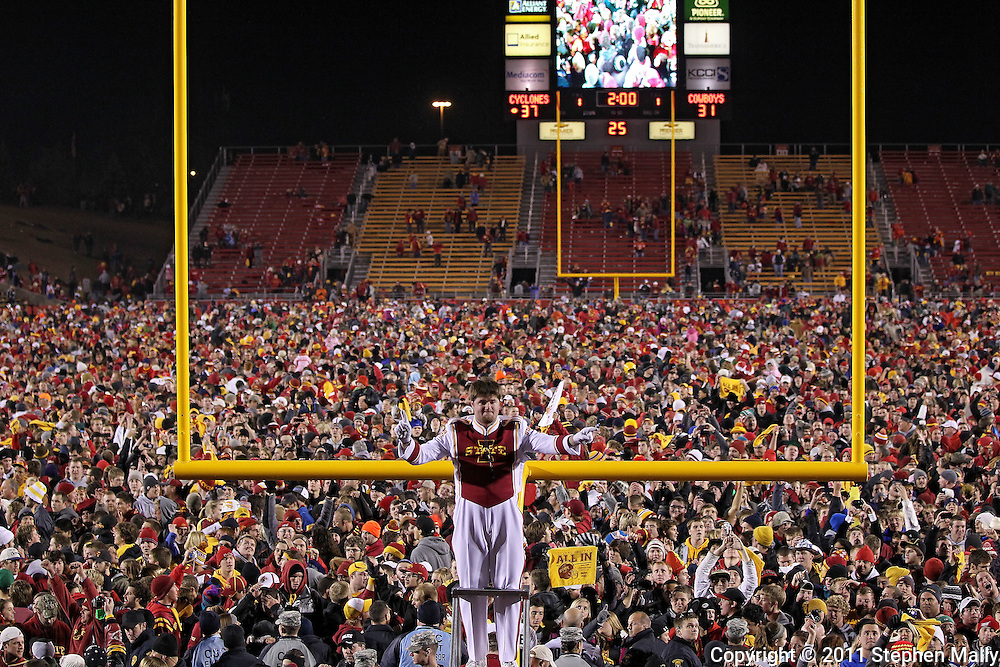 November 18, 2011: The Iowa State Marching Band plays after the end of the NCAA football game between the Oklahoma State Cowboys and the Iowa State Cyclones at Jack Trice Stadium in Ames, Iowa on Friday, November 18, 2011. Iowa State upset Oklahoma State 37-31.