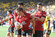 Crusaders Oliver Jager, George Bridge, and Will Jordan celebrate a try in the Super Rugby match, Hurricanes v Crusaders, Sky Stadium, Wellington, Sunday, April 11, 2021. Copyright photo: Kerry Marshall / www.photosport.nz
