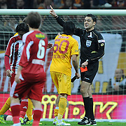 Referee's Bulent Yildirim show the red card to Galatasaray's Engin Baytar (C) during their Turkish Superleague soccer match Galatasaray between Sivasspor at the Turk Telekom Arena at Aslantepe in Istanbul Turkey on Saturday 26 November 2011. Photo by TURKPIX