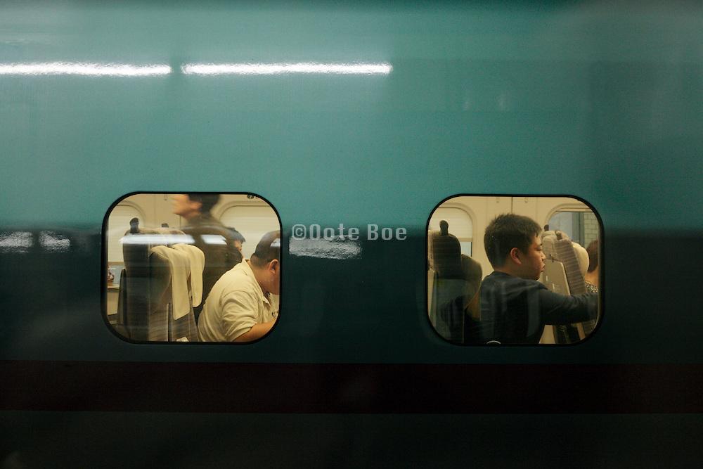 Japan Tokyo people waiting in a shinkansen bullet train wagon