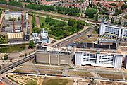 Nederland, Noord-Brabant, Eindhoven, 27-05-2013; Strijp-S, voormalige Philipsterrein, was niet toegankelijk voor het publiek, 'de verboden stad'. Het gebied, met diverse Rijksmonumenten, wordt ontwikkeld voor wonen, werken en cultuur.<br /> Boven in beeld - rechts - Philitefabriek met Klokgebouw (Strijp S), in het midden het Veemgebouw met daar direct naast De Hoge (Witte) Rug. <br /> Strijp-S, former Philips area, was not accessible to the public, 'the forbidden city'. The area, with several national monuments, is designated for living, working and culture.<br /> Top image Philitefabriek / Clock Building (Strijp S), in the middle of the Veemgebouw next to the High (White) Back. <br /> luchtfoto (toeslag op standard tarieven);<br /> aerial photo (additional fee required);<br /> copyright foto/photo Siebe Swart