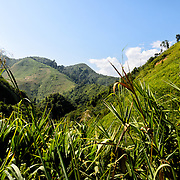 Some of the rugged mountainous landscape of the Luang Namtha region in northern Laos. Farmers grow mountain rice on the steep hillsides.