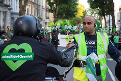 London, UK. 14 June, 2019. A motorcycle rider from UnitedRide4Grenfell greets Zeyad Cred, organiser of the Grenfell Silent Walk, on the second anniversary of the Grenfell Tower fire on 14th June 2017 in which 72 people died and over 70 were injured.