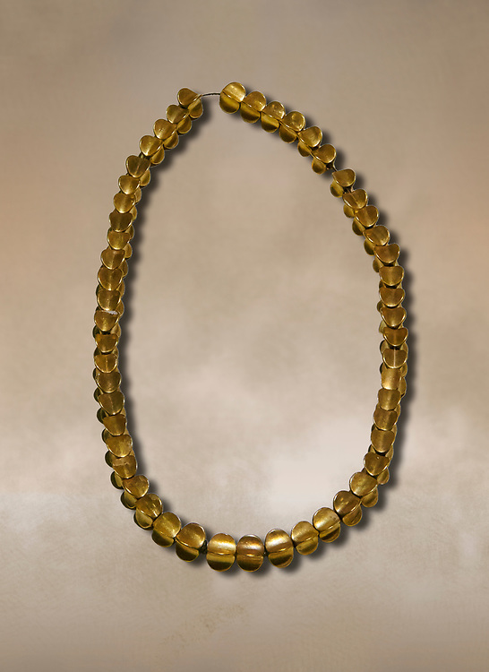 Bronze Age Hattian gold necklace from Grave L,  possibly a Bronze Age Royal grave (2500 BC to 2250 BC) - Alacahoyuk - Museum of Anatolian Civilisations, Ankara, Turkey. Against a warm art background .<br /> <br /> If you prefer to buy from our ALAMY PHOTO LIBRARY  Collection visit : https://www.alamy.com/portfolio/paul-williams-funkystock/royal-tombs-alaca-hoyuk-bronze-age.html (TIP refine search by adding background colour in the LOWER search box)<br /> <br /> Visit our ANCIENT WORLD PHOTO COLLECTIONS for more photos to download or buy as wall art prints https://funkystock.photoshelter.com/gallery-collection/Ancient-World-Art-Antiquities-Historic-Sites-Pictures-Images-of/C00006u26yqSkDOM