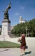 Woman tourist standing by monument statue of Pedro Álvares Cabral, Rio de Janeiro, Brazil 1962