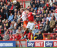 Blackpool's Neil Bishop beats Charlton Athletic's Michael Morrison  in the air<br /> <br /> Photo by Kieran Galvin/CameraSport<br /> <br /> Football - The Football League Sky Bet Championship - Charlton Athletic v Blackpool -  Saturday 5th October 2013 - The Valley - London<br /> <br /> © CameraSport - 43 Linden Ave. Countesthorpe. Leicester. England. LE8 5PG - Tel: +44 (0) 116 277 4147 - admin@camerasport.com - www.camerasport.com