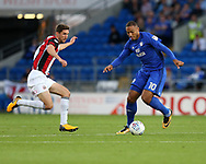 Kenneth Zohore of Cardiff city (10) is challenged by Chris Basham of Sheffield United (l). EFL Skybet championship match, Cardiff city v Sheffield Utd at the Cardiff City Stadium in Cardiff, South Wales on Tuesday 15th August 2017.<br /> pic by Andrew Orchard, Andrew Orchard sports photography.