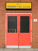 Red doors to car park stairs access to all levels, NCP Foundation Street car park, Ipswich, UK