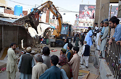 April 3, 2017 - Pakistan - QUETTA, PAKISTAN, APR 03: Views during anti encroachment drive operated by Quetta .Metropolitan Corporation at Meezan Chowk in provincial capital, on Monday, April 03, 2017. .Assistant Commissioner Batool Asadi supervise the drive. (Credit Image: © PPI via ZUMA Wire)