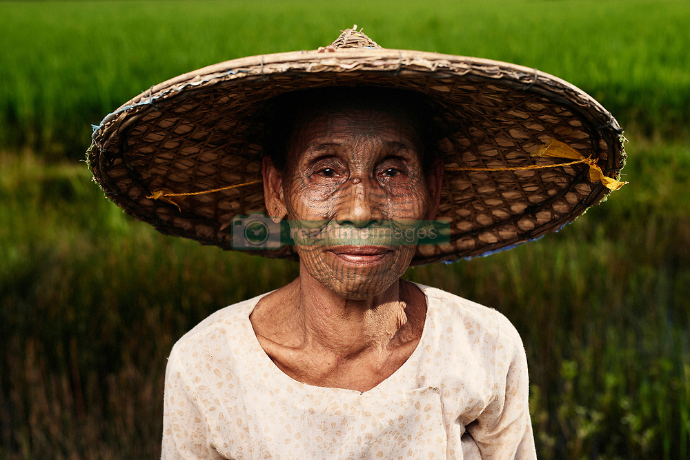 """Polish photographer, Adam Koziol has travelled all over the world to document ancient and primitive tribes. This time, he has captured the beauty and magic of the Chin tribe in Chin State in Burma. The women photographed in his photos come from the last generation of the Chin tribe who have their faces tattooed.<br /> <br /> The Chin tribe came about when decades ago, the Burmese king would travel to the area inhabited by women from the Chin tribe. He was in awe of what he saw and because it left such a big impression on him, he kidnapped on of the girls. From then on, Chin families started to tattoo their daughters faces and other parts of their body to make sure they would never be kidnapped. Girls between the ages of 12 and 14 would also have their ears pierced so they could wear bigger earrings – a symbol of feminine beauty but also so they could become part of the tribe and be less appealing to the Burmese king. It would take more than a day for the girls to have their faces tattooed and was an extremely painful process – especially on their eyelids. <br /> <br /> The tattoos are not made with ink, but rather with leaves, grass shoots and soot. The mixture was then tattooed on with sharp cane thorns. The Burmese socialist government put a ban on this tradition in the 60s. <br /> <br /> """"I want to show the beauty of cultures and the variety of origins of people from all over the world. I am fascinated in particular by tattoos and scarification's of tribes"""" says Adam. """"I develop relationships with people before creating photos and spend as much time with them as possible, really getting to know them and their culture."""""""