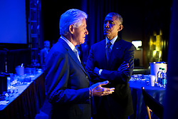 President Barack Obama speaks with former President Bill Clinton backstage prior to delivering remarks during the Clinton Global Initiative in New York, N.Y., Sept. 23, 2014. (Official White House Photo by Pete Souza)<br /> <br /> This official White House photograph is being made available only for publication by news organizations and/or for personal use printing by the subject(s) of the photograph. The photograph may not be manipulated in any way and may not be used in commercial or political materials, advertisements, emails, products, promotions that in any way suggests approval or endorsement of the President, the First Family, or the White House.