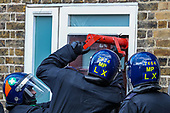 Britain Police Storm into a Flat in South London
