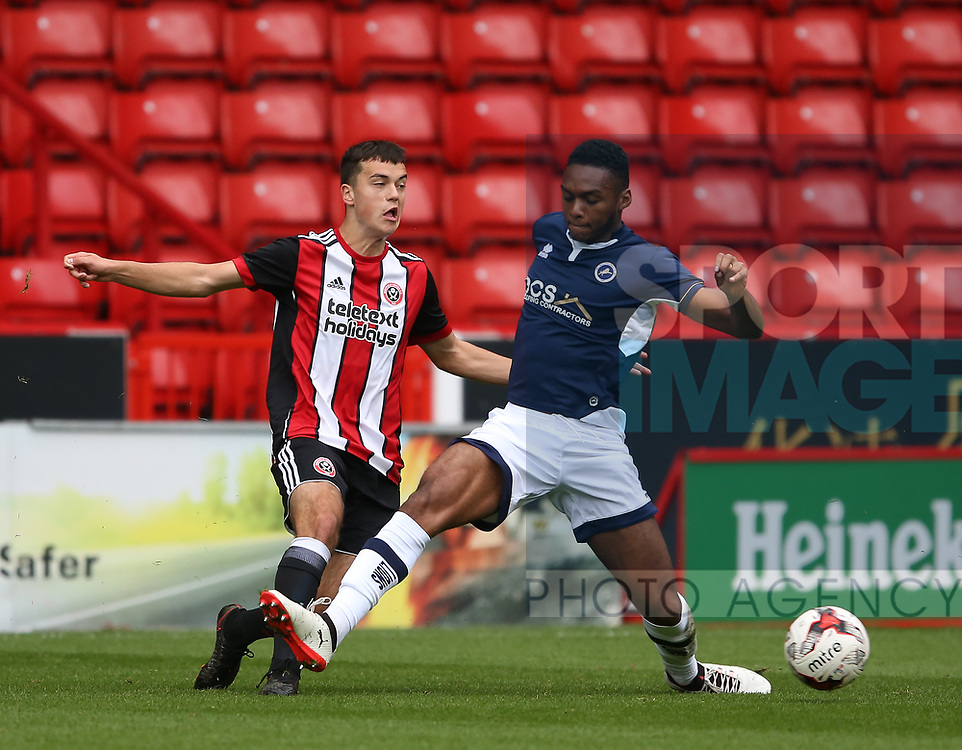 Jordan Doherty of Sheffield Utd tackled by Mahlon Romeo of Millwall during the U23 Professional Development League Two match at Bramall Lane Stadium, Sheffield. Picture date 18th August 2017. Picture credit should read: Simon Bellis/Sportimage