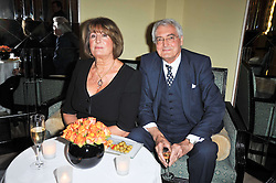 LADY ANNABEL GOLDSMITH and her brother the MARQUESS OF LONDONDERRY at a party to celebrate the publiction of 'No Invitation Required' by Annabel Goldsmith, held at Claridge's, Brook Street, London on 11th November 2009.