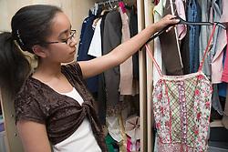 Teenage girl in her bedroom,