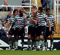 Photo. Jed Wee, Digitalsport<br /> Feyenoord Rotterdam v Sporting Lisbon, Newcastle Gateshead Cup, 31/07/2004.<br /> Sporting's Hugo Vieira (C) is mobbed after giving Sporting the lead.