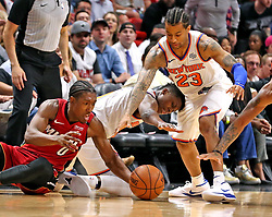 March 21, 2018 - Miami, FL, USA - The Miami Heat's Josh Richardson (0) and the New York Knicks' Try Burke hit the deck for a loose ball in the second quarter at the AmericanAirlines Arena in Miami on Wednesday, March 21, 2018. (Credit Image: © Charles Trainor Jr/TNS via ZUMA Wire)